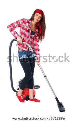young attractive brunette female uses vacuum cleaner, isolated on white background - stock photo
