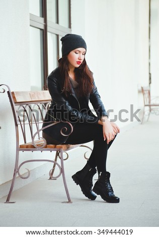 Young attractive brunette girl walk down the street - stock photo