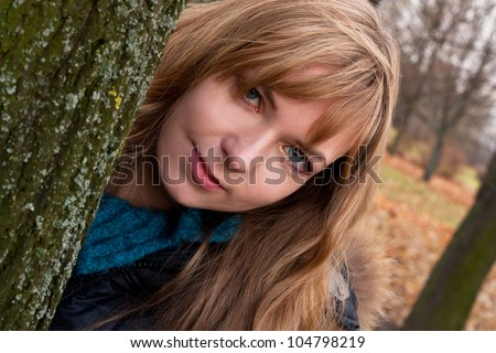Young attractive brunette in the park