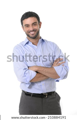 young attractive business man standing in corporate portrait isolated on white background smiling with folded arms in shirt and suit trousers