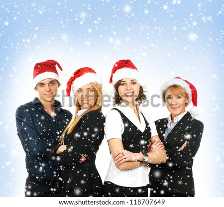 Young attractive business people in Christmas style - stock photo