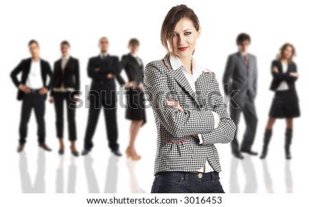 Young attractive business people - the elite business team - focus on the woman
