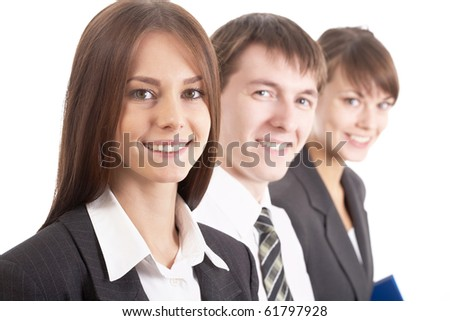 Young attractive business people with focus only on businesswoman - stock photo