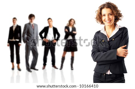 Young attractive business people with leader in front of them - stock photo