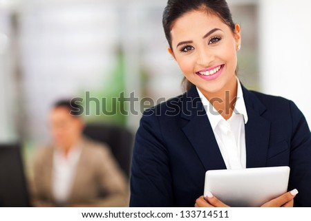 young attractive business woman holding a tablet computer - stock photo