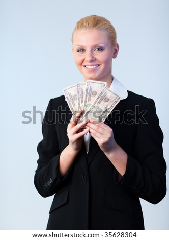 Young attractive Business woman holding dollars to the camera - stock photo