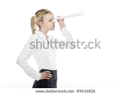 young attractive business woman looking through a spyglass made out of paper
