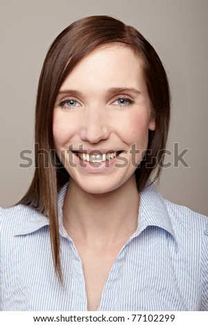 Young attractive business woman smiling into the camera - stock photo