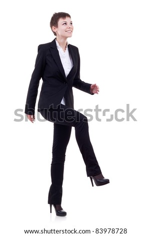Young attractive business woman stepping on imaginary step