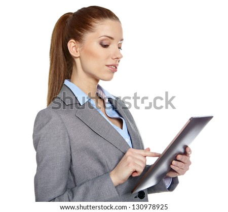 young attractive business woman uses a mobile tablet computer with touch screen - stock photo