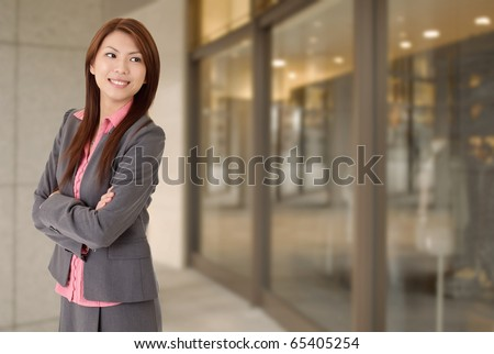 Young attractive business woman with smiling expression. - stock photo