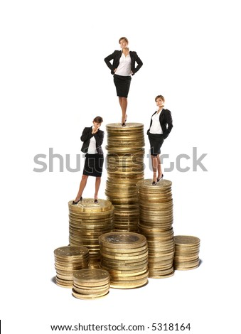 Young attractive businessladies on coin towers concept isolated on white