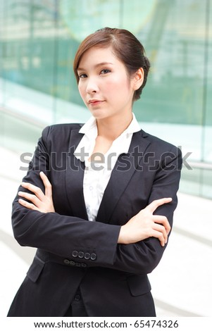 Young attractive businesslady in front of business building