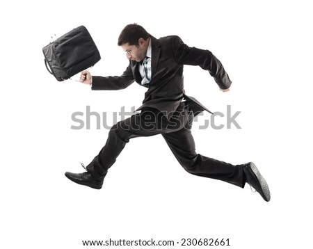 young attractive businessman in athletic pose running late to work wearing briefcase, suit and tie in stress and overwork or fast success concept isolated on white background - stock photo