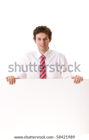 young attractive businessman in white shirt and red tie holds big blank white board, copyspace, studio shoot isolated on white background