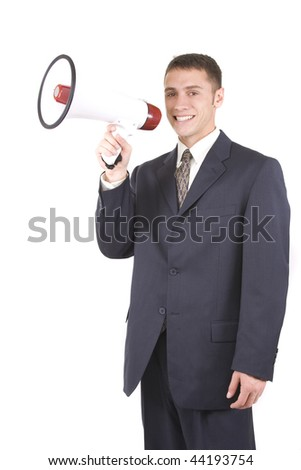 Young attractive businessman shouting into a megaphone. - stock photo