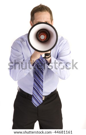 Young attractive businessman shouting into a megaphone.