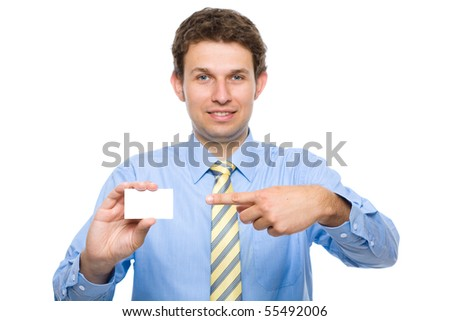 young attractive businessman shows his business card, white empty copy space, studio shoot isolated on white background - stock photo