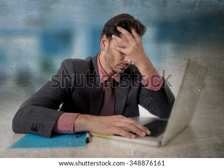young attractive businessman sitting at office desk working on computer laptop covering his face desperate and worried in work stress and business problems concept grunge edit - stock photo