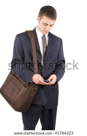 Young attractive businessman texting on a cell phone. - stock photo