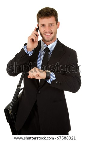 Young attractive businessman with briefcase and talking by phone, checking the time. Studio shot. White background. - stock photo