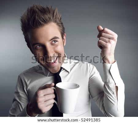 Young attractive businessman with cap have a happy mood