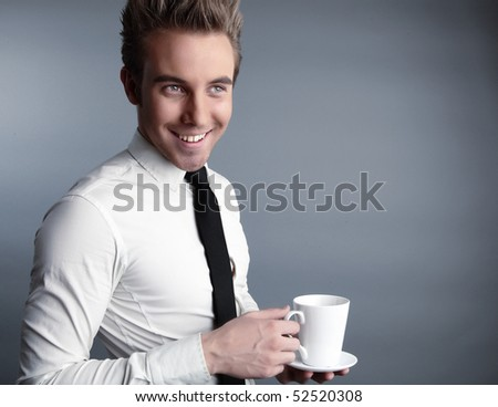 Young attractive businessman with cap have a happy mood - stock photo
