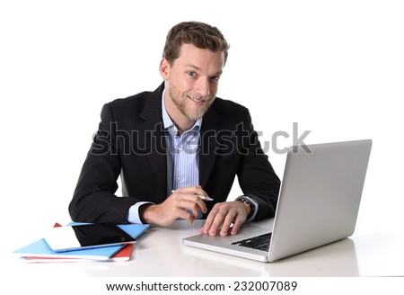 young attractive businessman working happy at computer desk satisfied and smiling relaxed looking laptop monitor in success at work concept isolated on white background  - stock photo