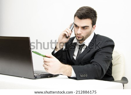 Young attractive Businessman working in front of computer