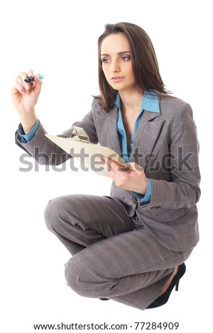 young attractive businesswoman draw in front of her, isolated on white background, crouch down pose - stock photo