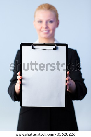 Young attractive businesswoman holding a clipboard - stock photo