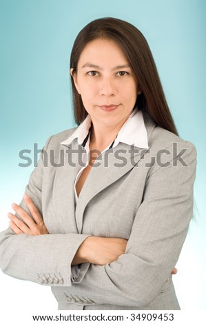 Young attractive businesswoman over light blue background - stock photo