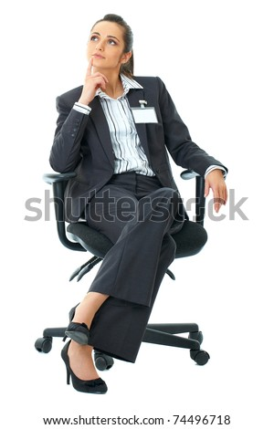 young attractive businesswoman sits on office chair, isolated on white background - stock photo