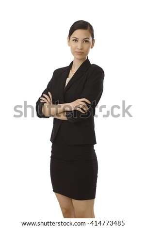 Young attractive businesswoman standing arms crossed, smiling. - stock photo