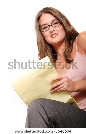 Young attractive businesswoman taking notes
