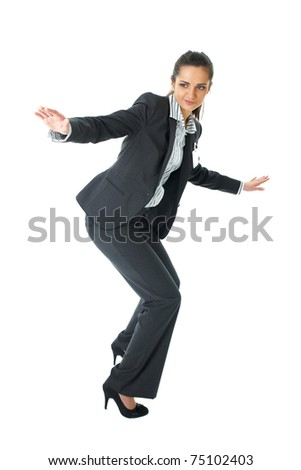 young attractive businesswoman try to hold balance, isolated on white background - stock photo