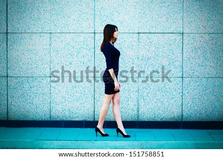 Young attractive businesswoman walking - stock photo
