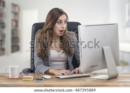 Young attractive businesswoman with a happy expression at office