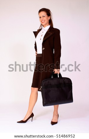 Young attractive businesswoman with briefcase