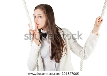Young attractive businesswoman with rope shows keep a silence gesture
