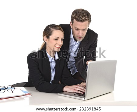 young attractive businesswoman working at computer laptop in office talking with work colleague smiling relaxed sitting and typing, following instructions from the boss in friendly relationship  - stock photo