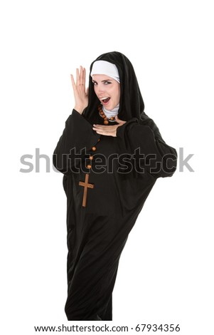 Young, attractive Catholic nun dancing on a white background - stock photo