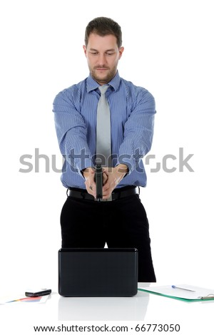 Young attractive caucasian businessman pointing with the gun. Studio shot. White background.
