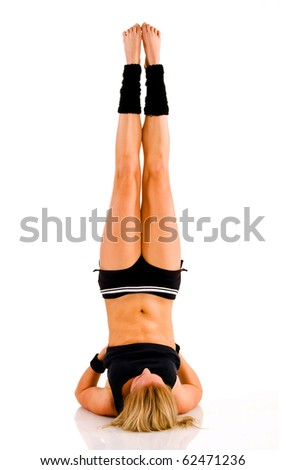 Young attractive Caucasian fitness woman doing gymnastics in front of white background - stock photo