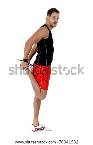 Young attractive caucasian man athlete doing fitness exercises, flexed leg. White background. Studio shot.