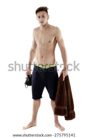 Young attractive caucasian man swimmer with goggles and towel isolated over white background - stock photo