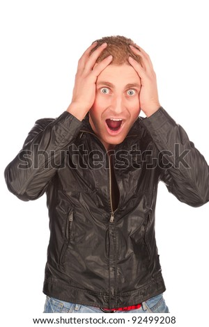 young attractive caucasian surprised man in black jacket, young beauty attractive emotional man, suddenly surprised screaming crazy mad man, isolated on white background