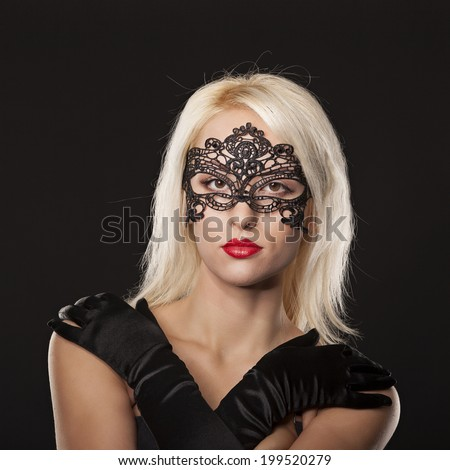 Young attractive Caucasian woman dressed in mourning clothes, face partially covered  - stock photo