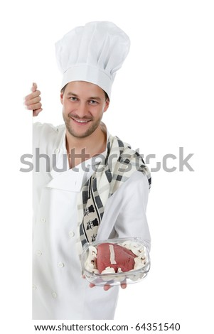 Young attractive chef caucasian male with hat and white uniform showing a raw roast beef and fresh mushrooms in glassware, ready for oven. Studio shot. White background. - stock photo
