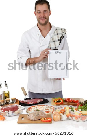 Young attractive chef caucasian male with uniform showing menu, diversity of uncooked meals. Studio shot. White background - stock photo